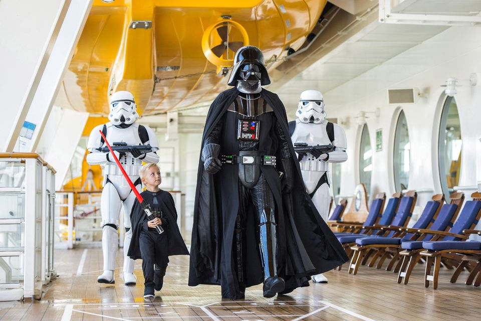 Darth Vader, storm troopers, and a young jedi aboard the Disney Fantasy's Star Wars Cruise