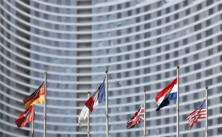 International flags in front of highrise
