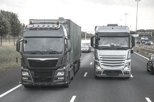 Two trucks on a highway