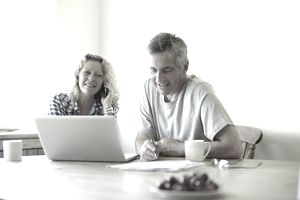man and woman on laptop and cell phone