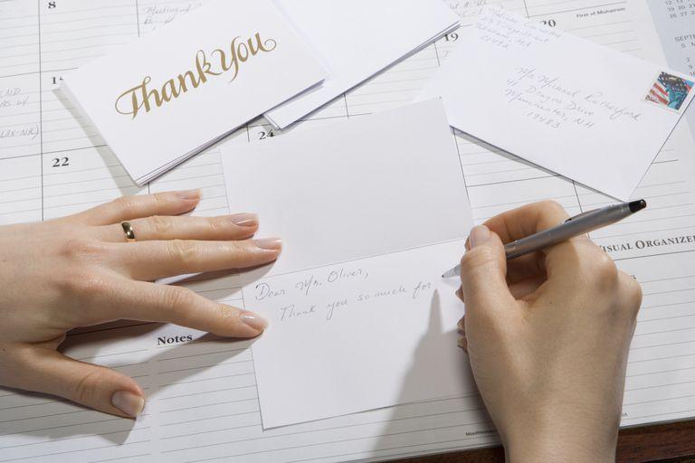 Woman writing thank youcard