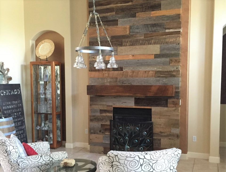 Check out 15 DIY fireplace surrounds made with reclaimed wood. Reclaimed wood