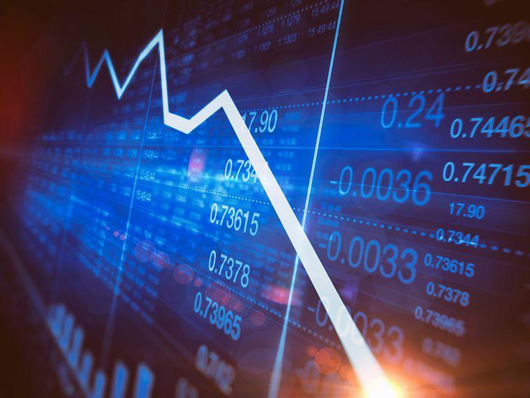 Decreasing line graph on stock market trading screen.