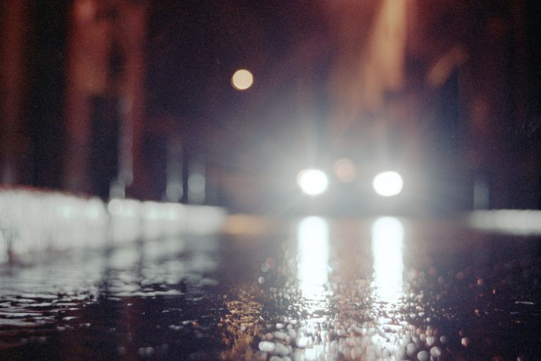 car headlights on a rainy night