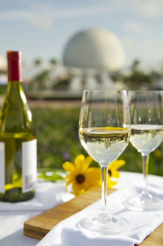 Wine Glasses with Epcot's Spaceship Earth in the background.