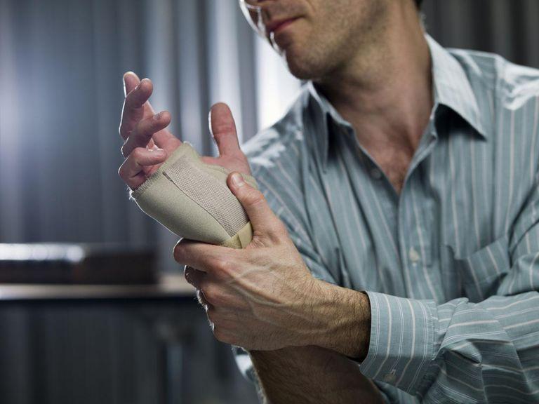 Businessman wearing wrist brace