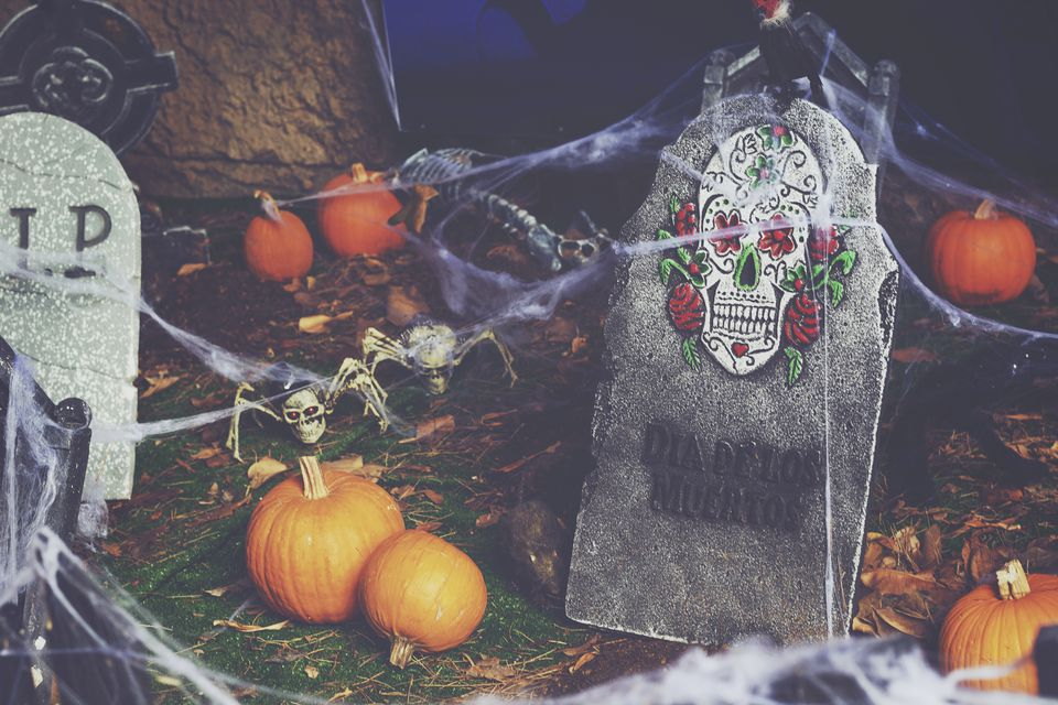 Halloween tombstones and pumpkins covered in cobwebs