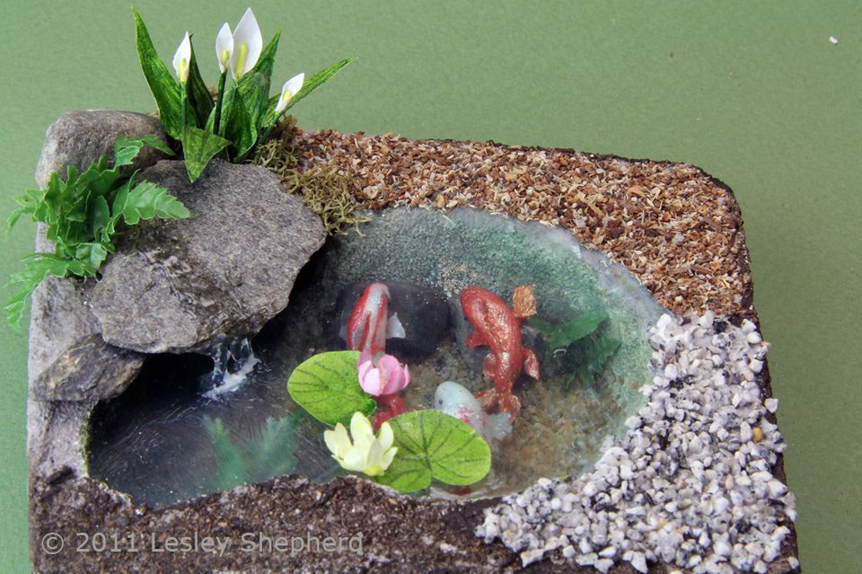 Range of materials used to landscape a dolls house scale fish pond