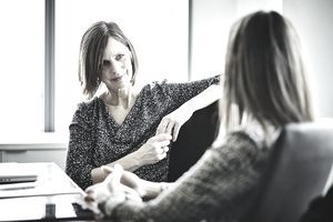 Mature businesswoman in discussion with colleague