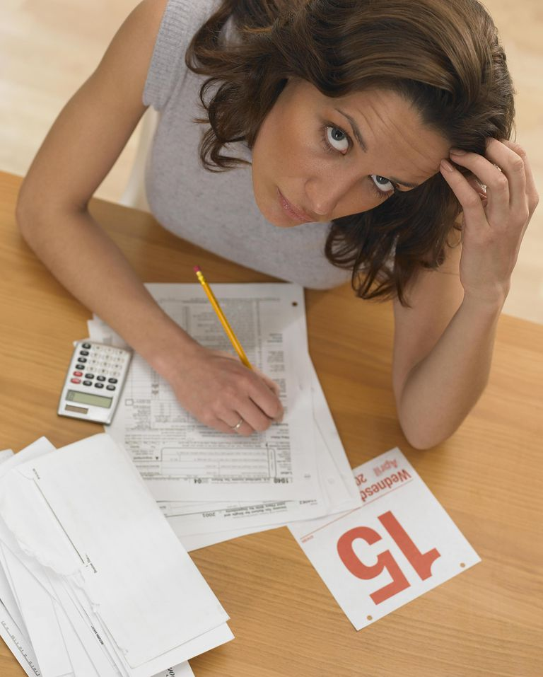 Woman struggling with income tax forms