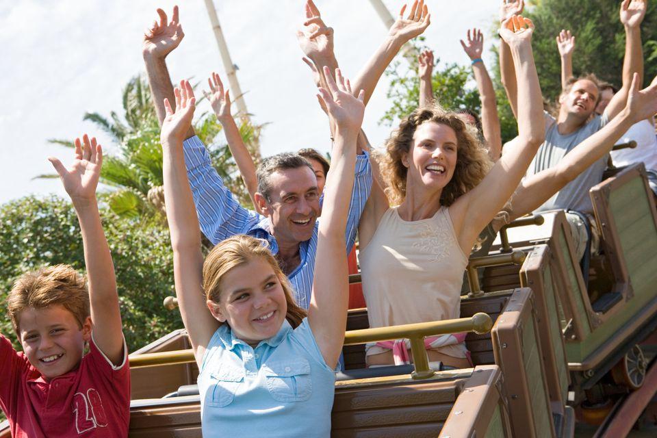 family on theme park roller coaster