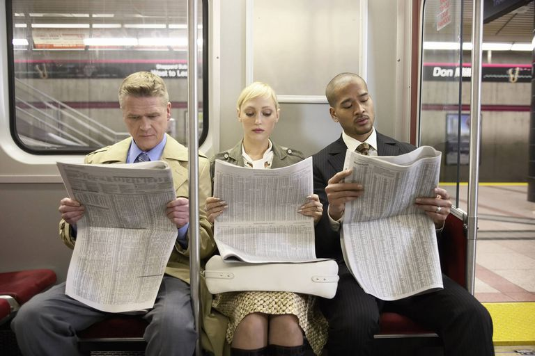 A picture of people reading a newspaper