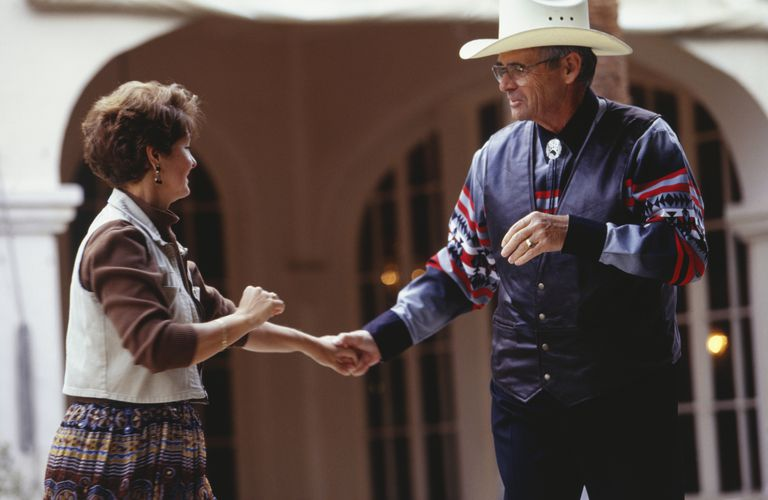 Couple square dancing, outdoors
