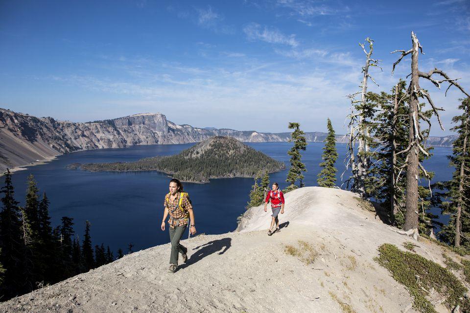 Hiking around Crater lake in Oregon. Two men hiking around Crater Lake.