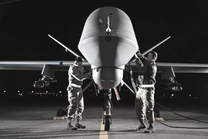 Airman 1st Class Steven (left) and Airman 1st Class Taylor prepare an MQ-9 Reaper for flight during exercise Combat Hammer, May 15, 2014, at Creech Air Force Base, Nev. Reaper crews flew a week-long mission, where they released the GBU-12 Paveway II and AGM-114 Hellfire munitions. Steven and Taylor are MQ-9 Reaper crew chiefs from the 432nd Aircraft Maintenance Squadron.