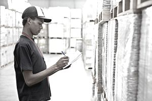 a man taking inventory in a in warehouse