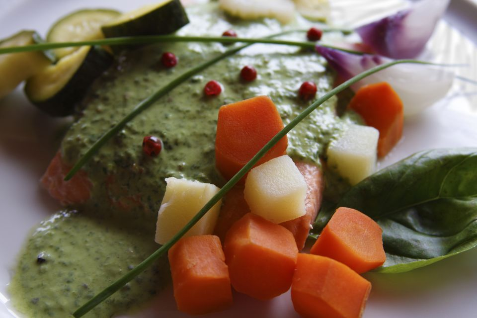 Salmon and steamed vegetables in green sauce