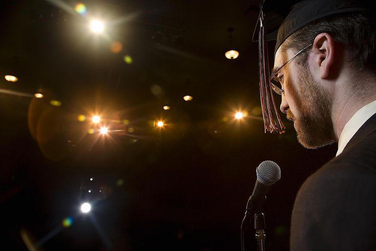 Graduate speaking on microphone