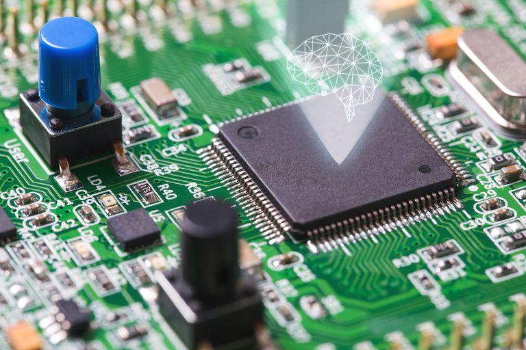 Computer microchip projecting a human brain.