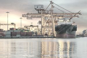 Freight ship loading cargo container in port