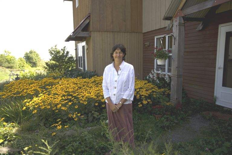 Liz Walker, co-founder of EcoVillage at Ithaca (EVI), outside her home in 2007