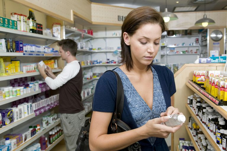Woman looking at products in a pharmacy