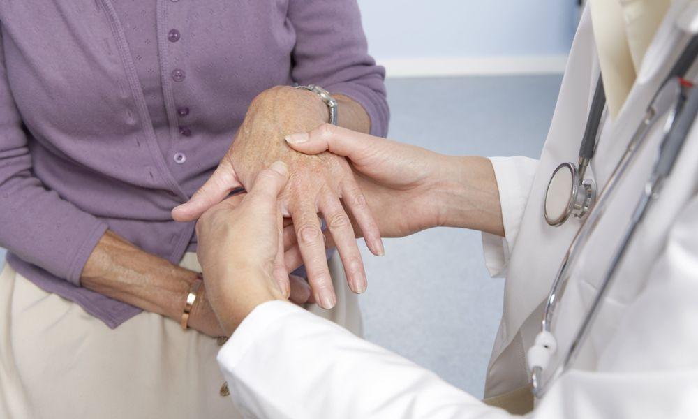 Doctor feeling patient's hand