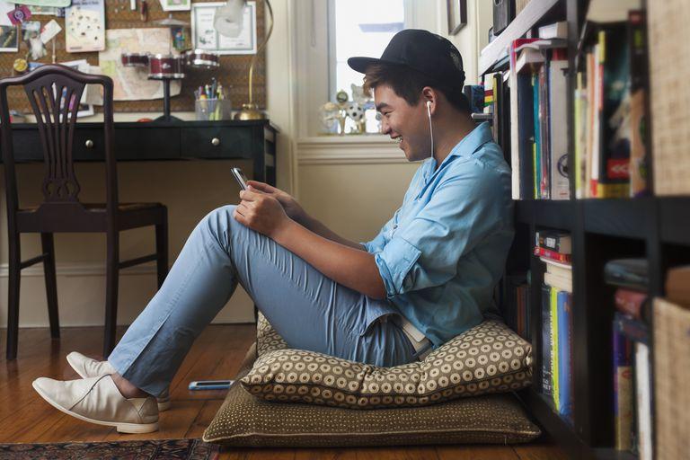 Teenager watching video on phone