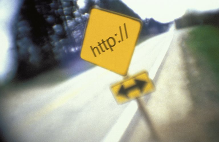 Yield sign on rural highway reading ''http://