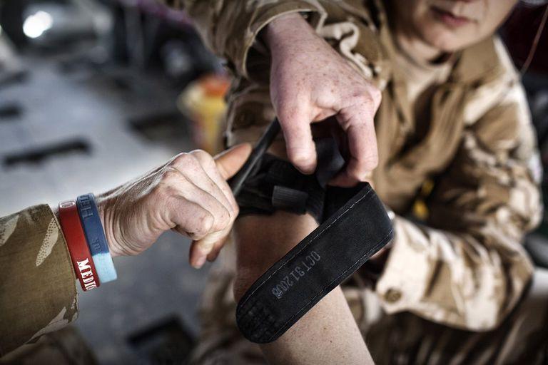 Soldier practicing tourniquet application