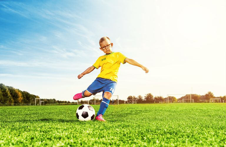 Kid kicking soccer ball