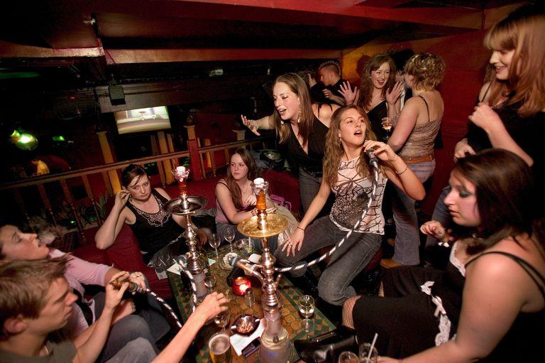 Young Adults Partying at Hookah Bar
