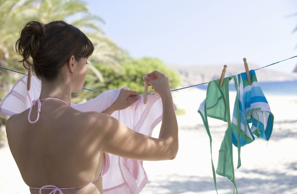 Woman hanging laundry on washing line