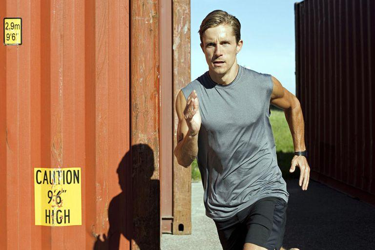 Man running in industrial area