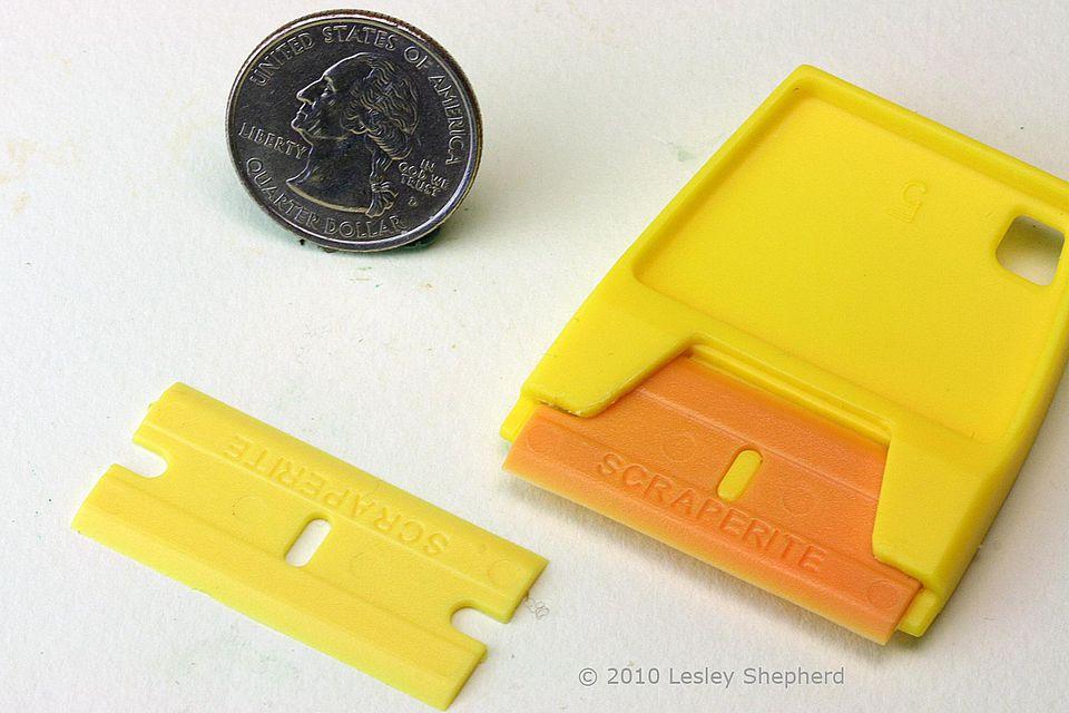 Scraperight plastic razor blade and blade holder.