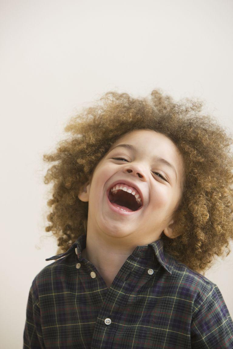 Mixed race boy laughing