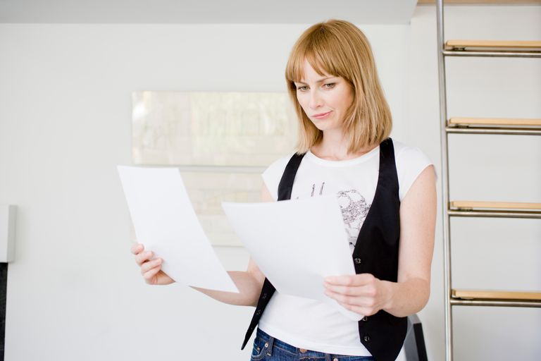 woman reviewing documents