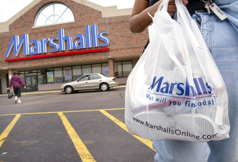 MOUNT PROSPECT - MAY 19: A shopper with her purchases walks to her car outside a Marshalls store May 19, 2004