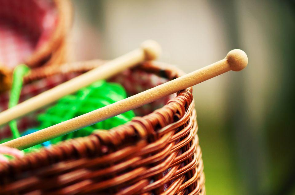 Knitting Needles and Green Yarn