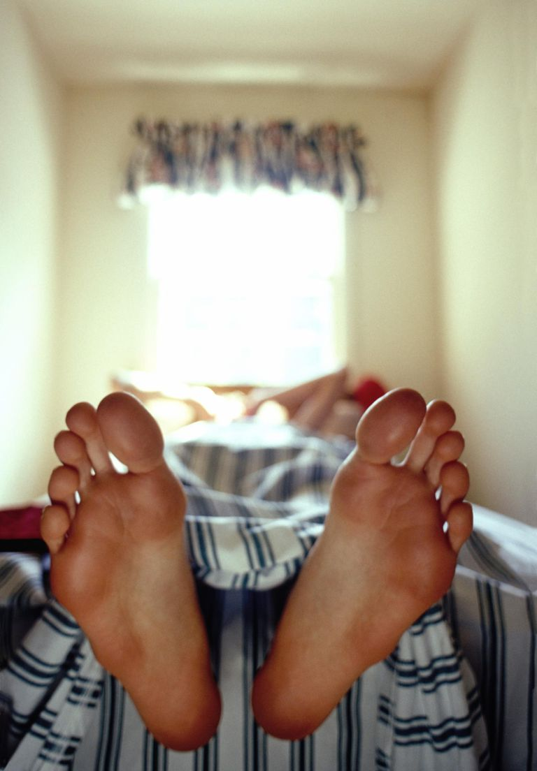 FEET OF TEENAGE BOY (15-17) IN BED