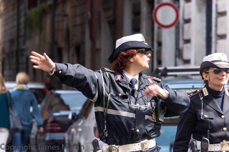 rome traffic cop giving directions
