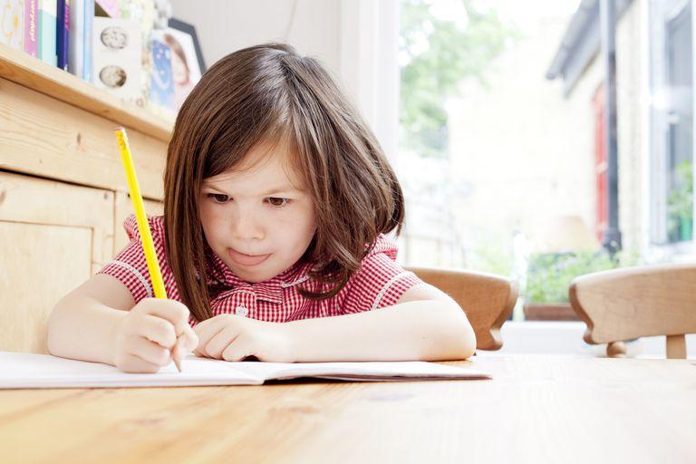 girl working hard at school work