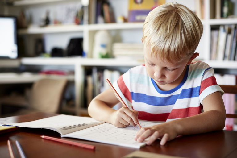 Boy coloring at table