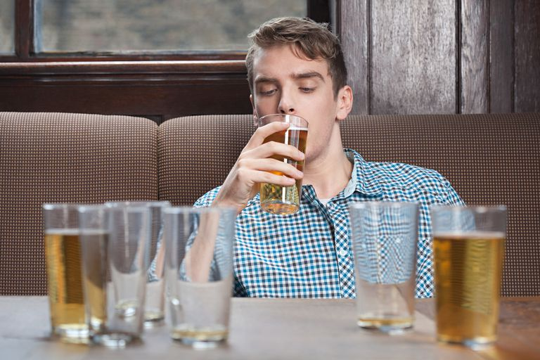 Man drinking.