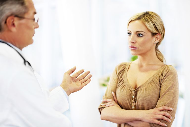 Woman talking with dermatologist.