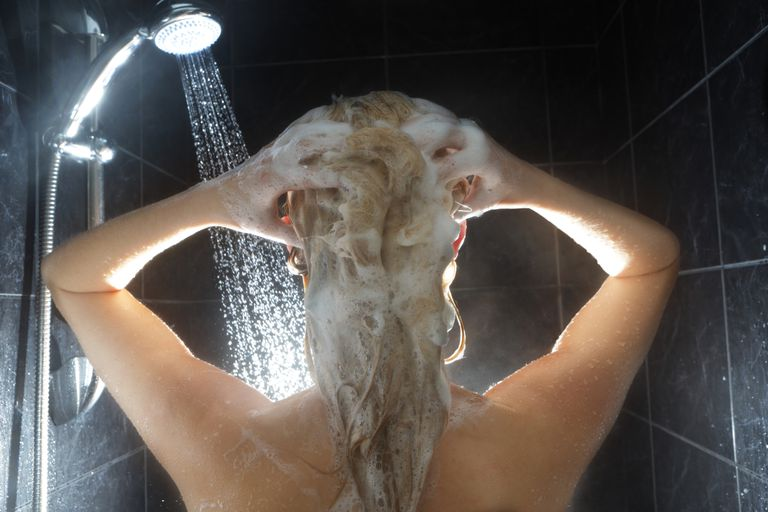 woman shampooing with gluten-free shampoo