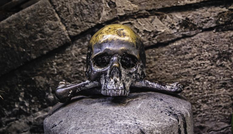 Black Skull bronze marks the entrance to the church of the Souls in Purgatory - Province of Naples, Campania, Italy