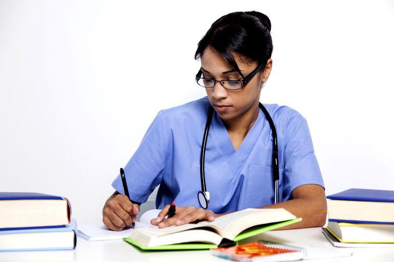 Female doctor studying books