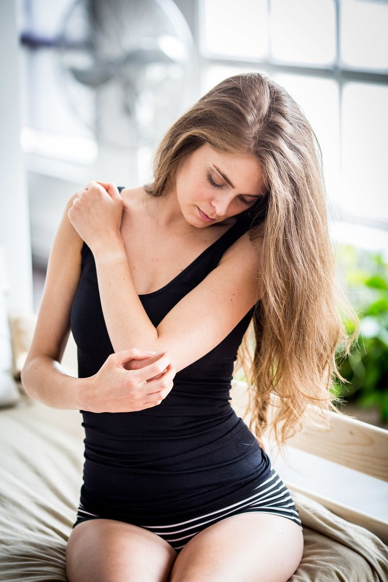 Woman itching her neck