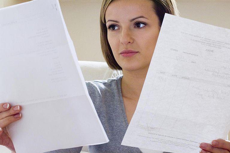 Young woman checking bill, close-up'